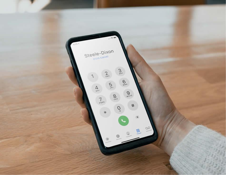 Smartphone screen shows Steele dixon calling